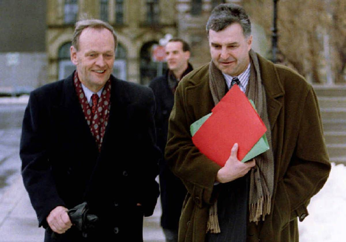 Prime Minister Jean Chretien walks with his press secretary Patrick Parisot after a news conference in Ottawa on Jan. 16, 1993.