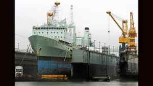 The 40-year-old supply ship HMCS Preserve sits in a dry dock at the Halifax Shipyard during a scheduled refit in Halifax, Nova Scotia, July 14, 2010. Peter MacKay, Minister of National Defence, announced the go ahead for the $2.6 billion Joint Supply Ships (JSS) program which will replace the navy's supply ships.
