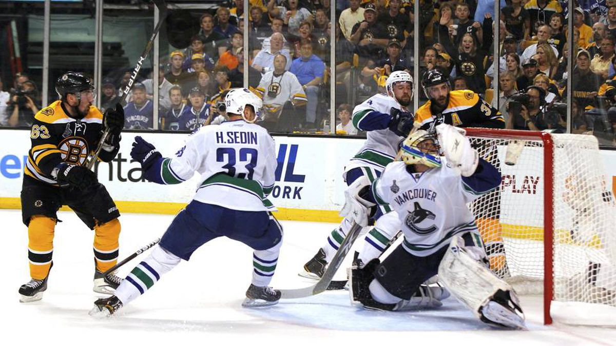 Boston Bruins left wing Brad Marchand scores on Vancouver Canucks goalie Roberto Luongo in the second period of Game 4.