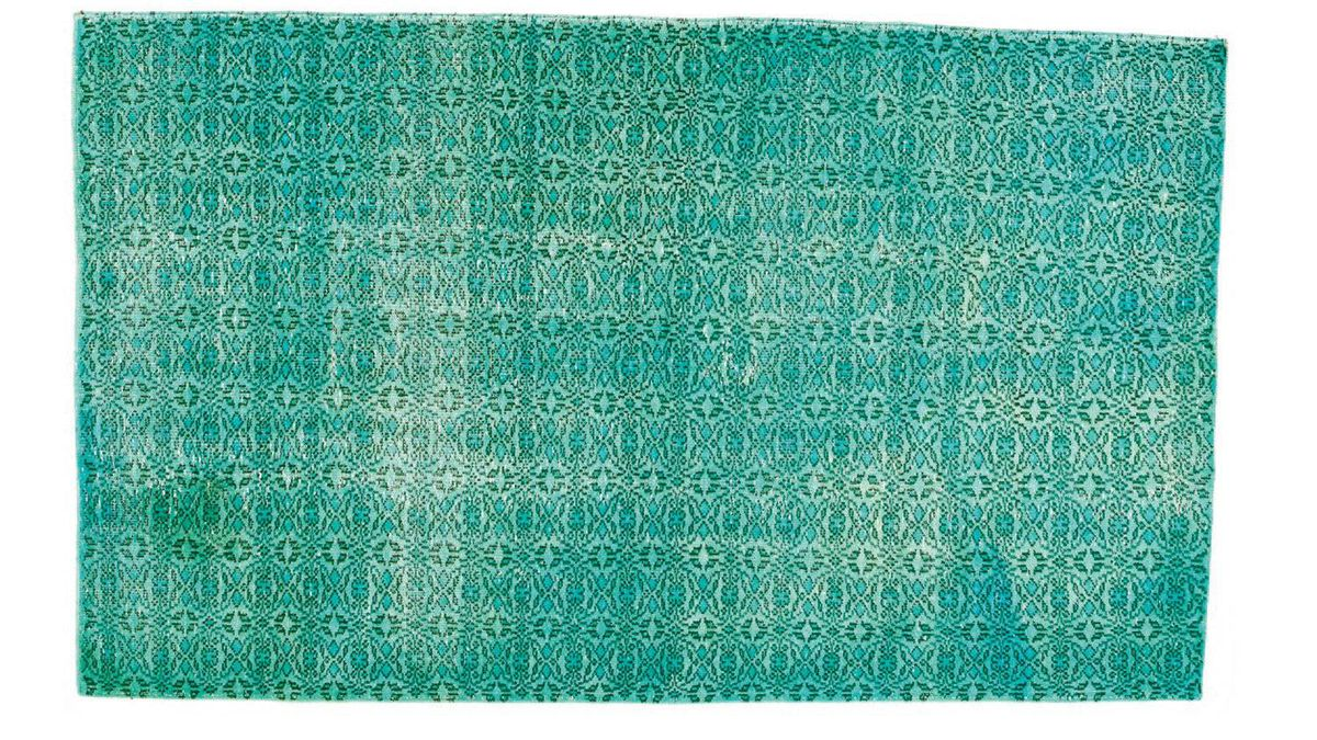 Hand-woven in Turkey, this vintage wool rug was soaked in lemon juice and left in the sun to enable natural colour neutralization and over-dyed to create a modern salvaged look. $2,799 plus shipping through www.abchome.com.