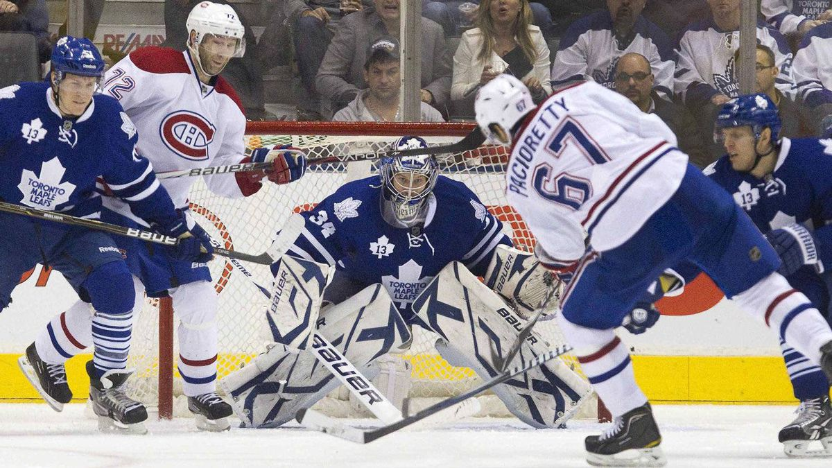 The Montreal Canadiens' Max Pacioretty scores on Toronto Maple Leafs goalie James Reimer in Toronto Feb. 11, 2012.
