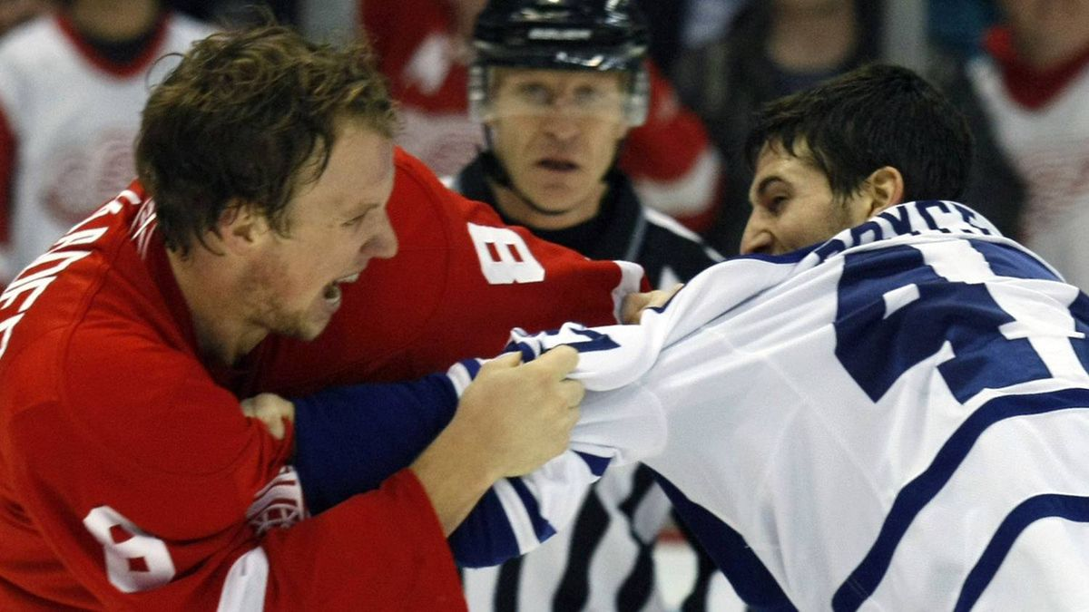 Toronto Maple Leafs left wing Darryl Boyce (R) and Detroit Red Wings left wing Justin Abdelkader fight each other during the second period of their NHL hockey game in Detroit, Michigan March 26, 2011. REUTERS/Rebecca Cook