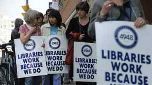 Toronto Public Library workers march outside Toronto Reference Library on March 19, 2012 after talks with the city stalled on the weekend. Toronto's 2,300 library employees walked off the job after 5 p.m. Sunday, shuttering 98 branches to bibliophiles across the city.