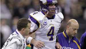 This Jan. 24, 2010, file photo shows Minnesota Vikings quarterback Brett Favre being helped off the field after being hit during the third quarter of the NFC Championship NFL football game against the New Orleans Saints, in New Orleans. The NFL says that New Orleans Saints players maintained a bounty program over the last three seasons that targeted opponents with the intent to injure them. The league disclosed the findings of an investigation Friday, saying between 22 and 27 defensive players and at least one assistant coach were involved. The NFL began its investigation in early 2010 after receiving allegations that quarterbacks Kurt Warner of Arizona and Brett Favre of Minnesota had been targeted. (AP Photo/Morry Gash, File)