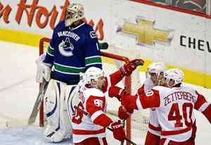 Vancouver Canucks goaltender Roberto Luongo looks on as the Detroit Red Wings celebrate a goal during first-period NHL hockey action in Vancouver on October 27, 2009.