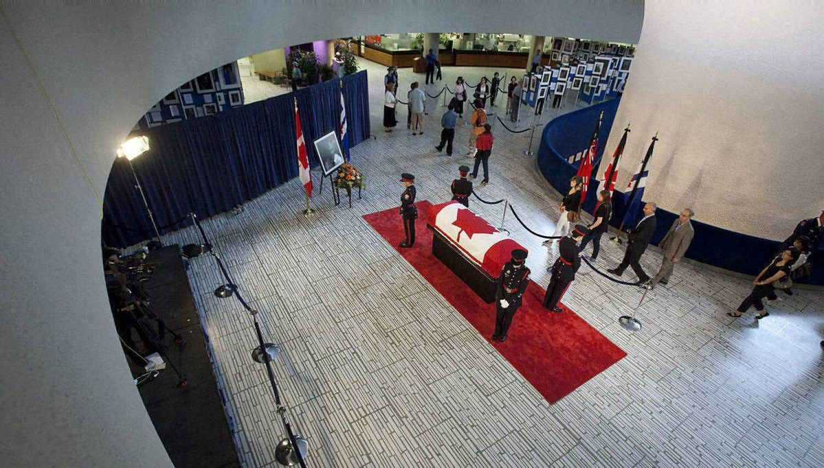 People pay their respects to Mr. Layton as he lies in repose at City Hall in Toronto, Ontario.