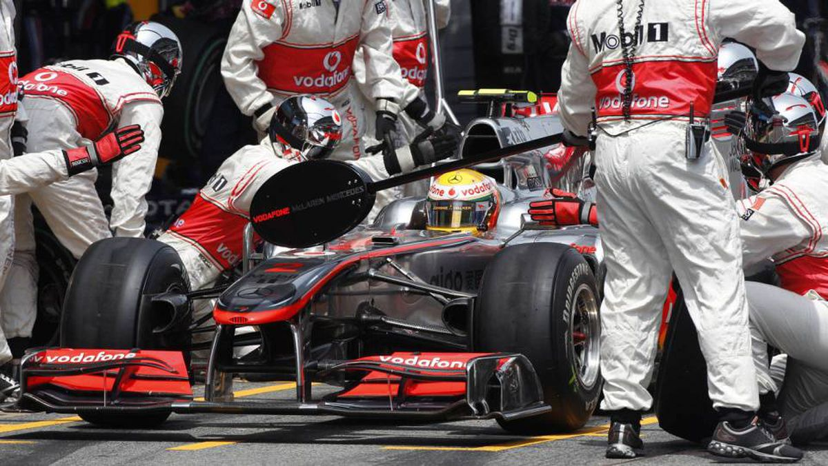 McLaren Formula One driver Lewis Hamilton of Britain waits during a pit stop during the Spanish F1 Grand Prix at Montmelo circuit, near Barcelona May 9, 2010.