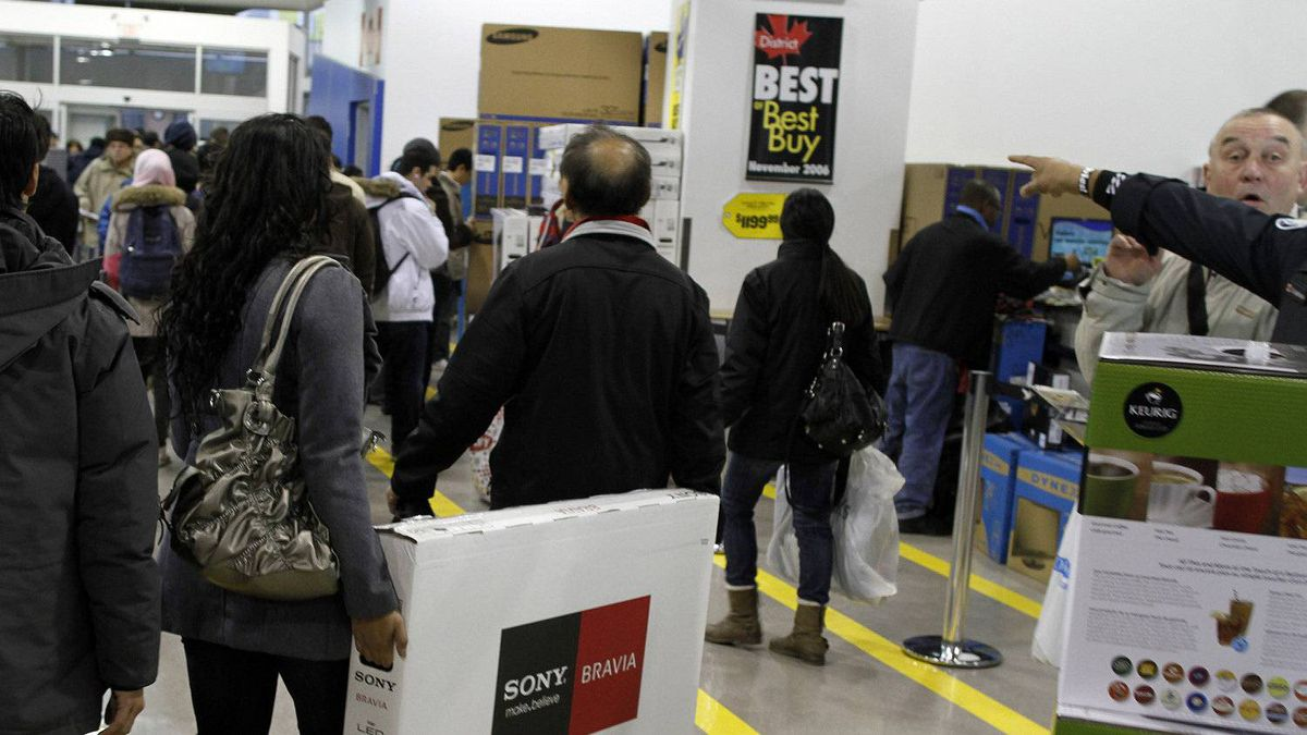Shoppers walk inside of the Best Buy store in downtown Toronto.
