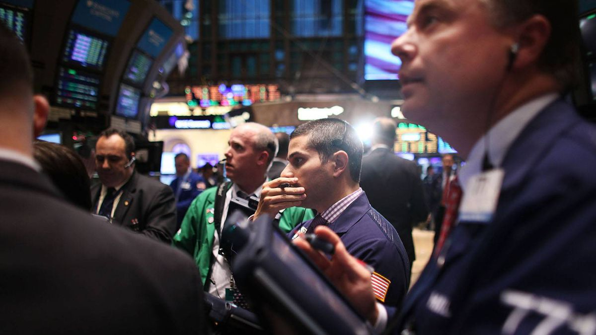 Traders work on the floor of the New York Stock Exchange on December 9, 2011 in New York City.