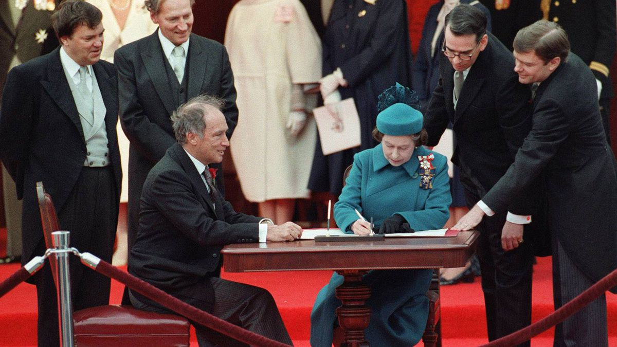 Queen Elizabeth II signs Canada's constitutional proclamation in Ottawa on April 17, 1982 as Prime Minister Pierre Trudeau looks on. The Charter of Rights and Freedoms has caused no end of squabbles among Canadians.