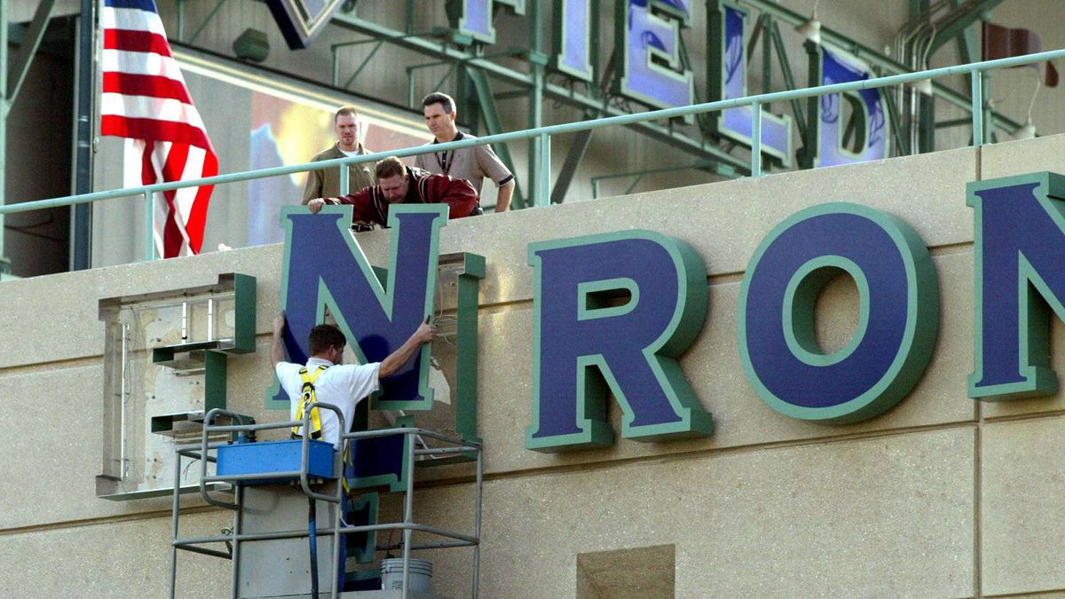 402709 01: Stadium employees remove letters from one of the Enron Field signs March 21, 2002 in Houston, TX. The Houston Astros paid $2.1 million to get back the naming rights to their stadium from collasped energy trader Enron.