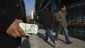 Money-changing touts like this man, seen Jan. 7, 2012, are a common sight in parts of Tehran, where they wave wads of currency at passing motorists and pedestrians.
