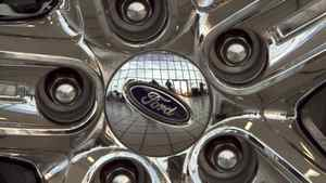 The Ford logo is displayed on a car wheel at a dealership in Omaha, Neb.