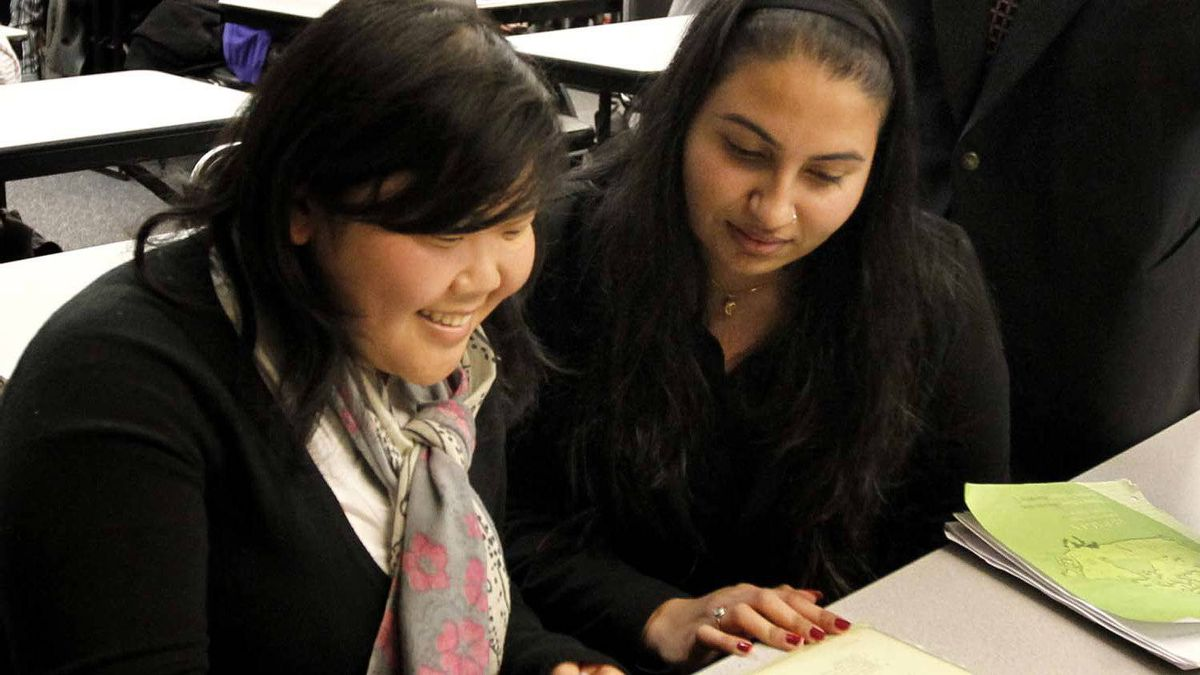 From left: Vancouver Community College International students Mutiara Santoso and Parvinder Kaur in class November 24, 2010 in Vancouver.