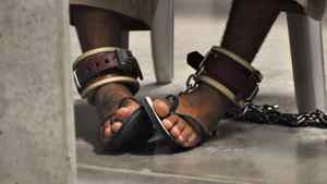 """In this photo, reviewed by a U.S. Department of Defense official, a Guantanamo detainee's feet are shackled to the floor as he attends a """"Life Skills"""" class inside the Camp 6 high-security detention facility at Guantanamo Bay U.S. Naval Base April 27, 2010."""