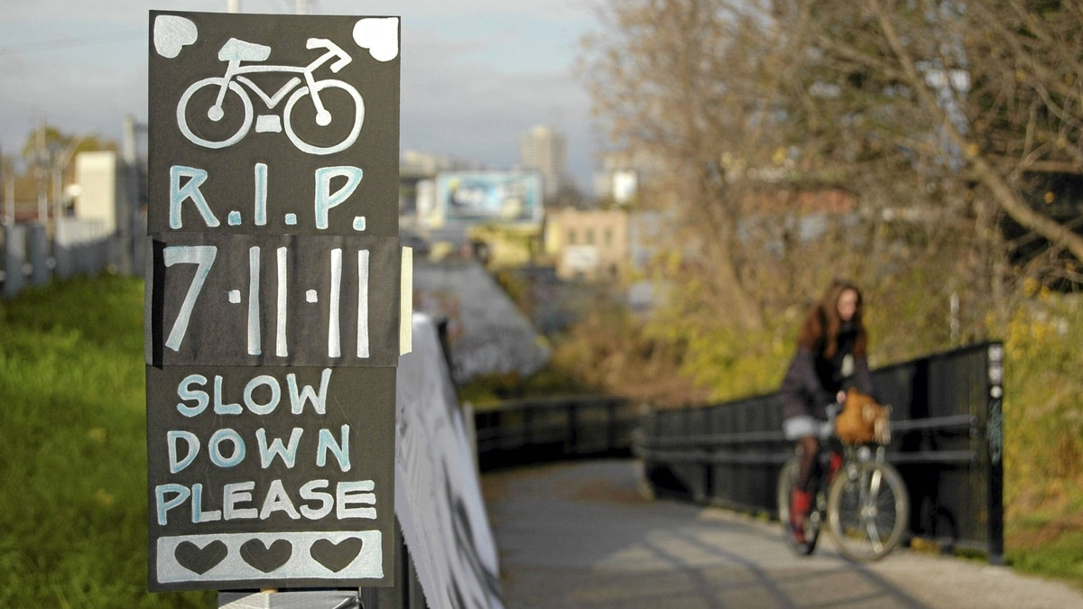 On the West Toronto Railpath, near the site of cyclist Jenna Morrison's fatal accident, a makeshift memorial sign