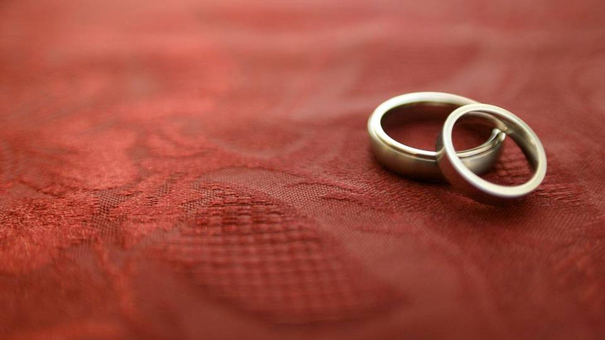 Wedding rings on a red tablecloth
