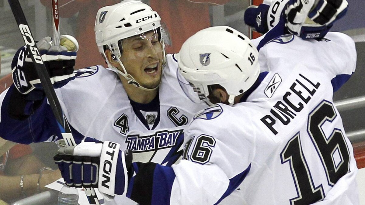 Tampa Bay Lightning's Vincent Lacavalier, left, and Teddy Purcell celebrate Lacavalier's goal during the overtime period in Game 2 of a conference semifinal NHL Stanley Cup hockey playoff series with teh Washington Capitals Sunday, May 1, 2011 in Washington. The Lightning won 3-2. (AP Photo/Alex Brandon)