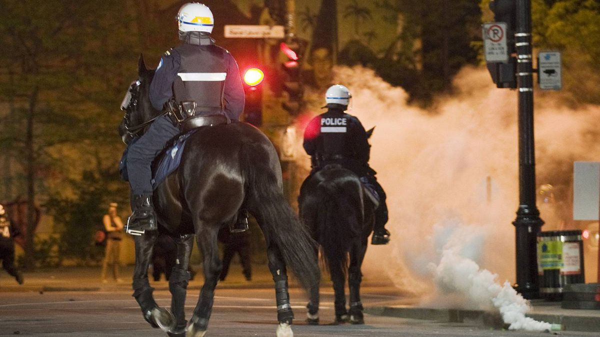 Police move in on protesters during a large demonstration designed as an act of defiance against a legal crackdown by the Quebec government, in Montreal, Friday, May 18, 2012.
