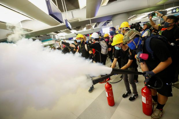 Protesters clash with police in Hong Kong as demonstration held to mark one month since subway mob attack