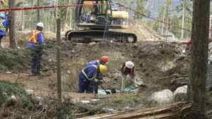 BC SPCA constables and forensic anthropologists exhume bodies at a mass grave of sled dogs near Whistler, B.C., May 8, 2011.