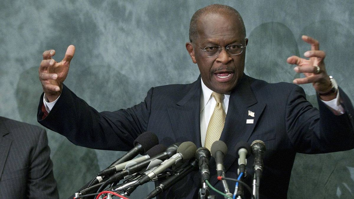 Republican presidential candidate Herman Cain gestures as he speaks to legislators in the Congressional Health Care Caucus on Capitol Hill in Washington November 2, 2011.