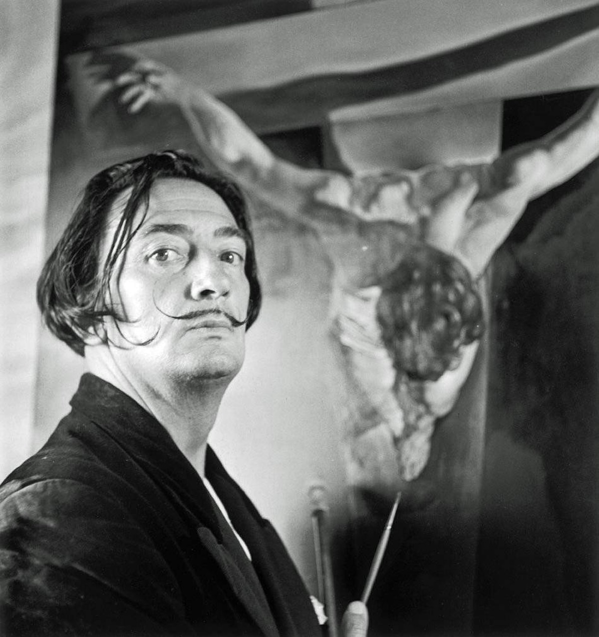 Salvador Dali stands next to his painting Christ of St John on the Cross, Cadaques, Spain, Nov. 17, 1951. The Surrealists will be featured at the Vancouver Art Gallery this summer.