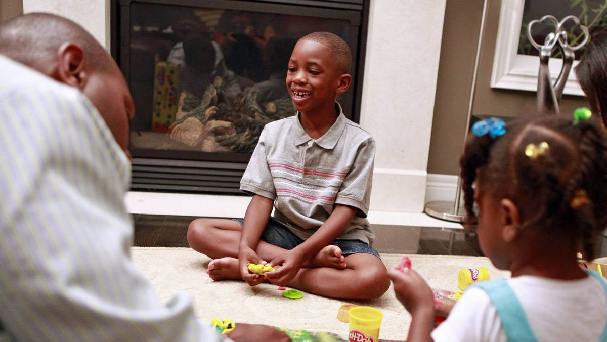 Mekhi Rutherford plays with his family in their home Aug. 18 in Markham, Ontario. Mekhi will be attending the full-day senior kindergarten class at Ellen Fairclough Public School this year.