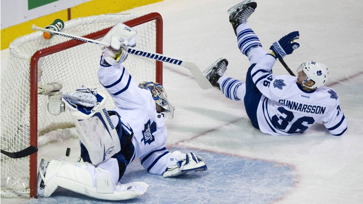 Toronto Maple Leafs goaltender Jonas Gustavsson, left, is scored on by Montreal Canadiens' Erik Cole (not shown) as Leafs' Carl Gunnarsson (36) looks on during first period NHL hockey action in Montreal, Saturday, March 3, 2012. THE CANADIAN PRESS/Graham Hughes