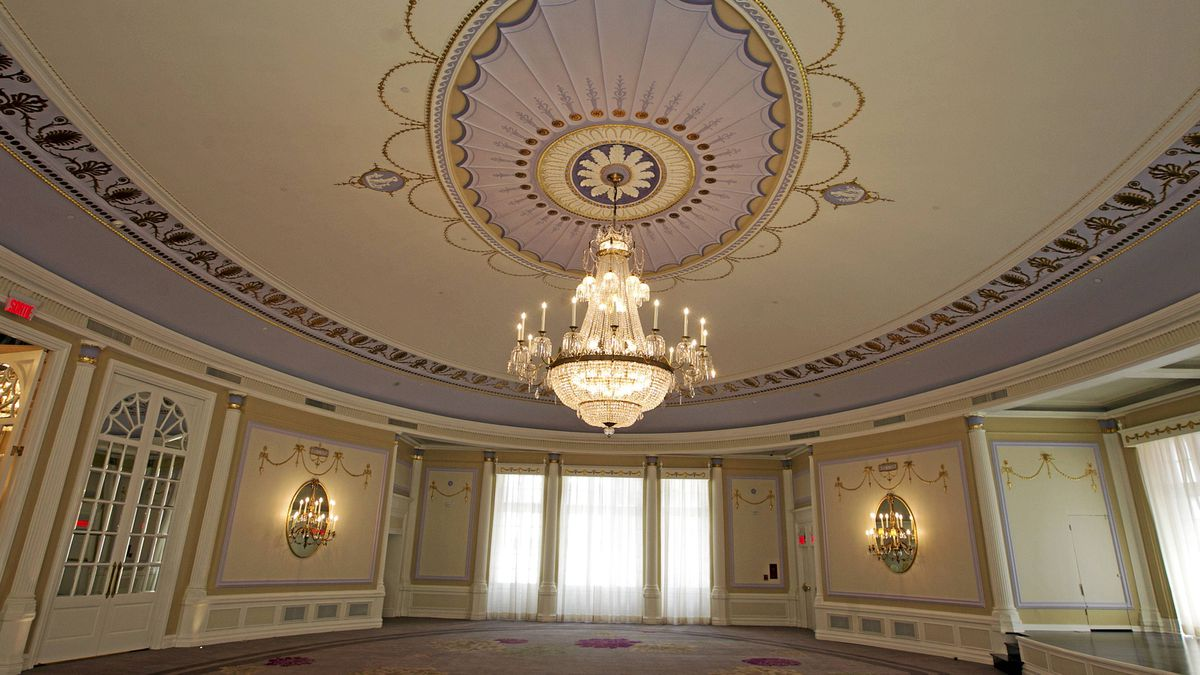 The refinished Oval Room sports shiny new gold leaf and hand-painted detail on the mouldings.