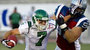 Saskatchewan Roughriders slotback Weston Dressler fends off Montreal Alouettes defensive tackle J.P. Bekasiak during second quarter CFL football action Sunday, July 24, 2011 in Montreal. The Roughriders won 27-24. THE CANADIAN PRESS/Paul Chiasson