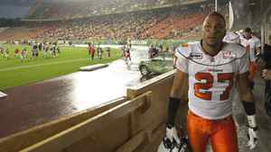 B.C. Lions' JR LaRose, right, watches as fans look for cover as lightening, heavy rain and high winds temporarily halt the Edmonton Eskimos Lions game during first half CFL action in Edmonton Friday July 30, 2010.