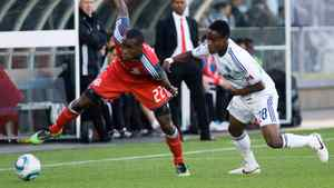 Toronto FC's Tony Tchani, left, is chased by Vancouver Whitecap's Gershon Koffie during first half game 1 Nutrilite Canadian Championship finals soccer action in Vancouver, B.C., on Wednesday May 18, 2011.
