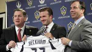 From left, AEG President and CEO Tim Leiweke, Los Angeles Galaxy's David Beckham and head coach Bruce Arena pose for photos during a soccer news conference in Los Angeles, Thursday, Jan. 19, 2012. Resisting the lure of Paris for the sake of his family, Beckham pledged his future to America's Major League Soccer on Wednesday by signing a new two-year contract with the Los Angeles Galaxy.