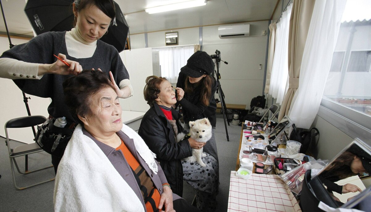Residents have their hair and make-up done before having their portraits taken for the 3.11 Portrait Project. The project was conceived by photographer Nobuyuki Kobayashi who takes portraits of Japan's earthquake survivors. The portraits are then sent to schoolchildren from non-disaster areas, who frame the portraits and send them back to the survivors along with personal messages of support.