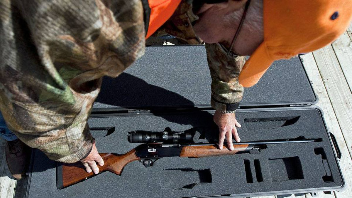 A gun enthusiast puts his rifle in a case at a hunting camp west of Ottawa on Sept. 15, 2010.