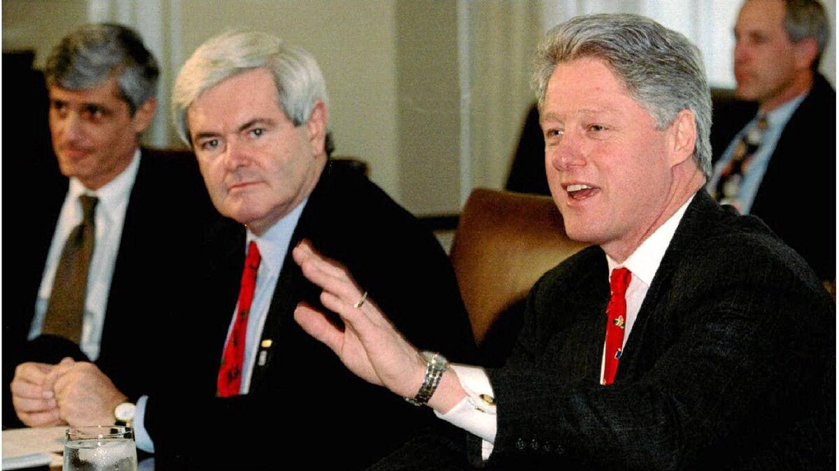 President Bill Clinton, right, speaks at the start of budget talks with congressional leaders at the White House, December 22, 1995, including Speaker of the House Newt Gringich