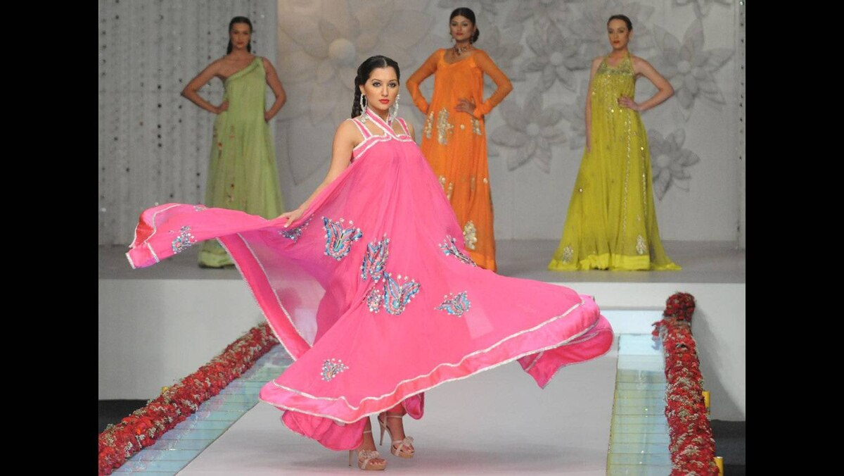 Models present creations by Pakistani designer La Chantal by Saba on the last day of Bridal Couture Week in Karachi on late April 24, 2011.