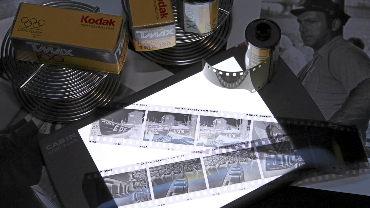 Eastman Kodak black and white film, negatives, film development reels and black and white photographic prints are shown Jan. 6, 2012 in this studio illustration in Washington.