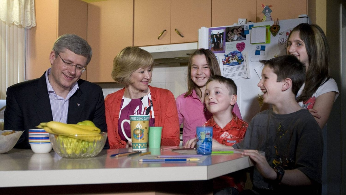 Prime Minister Stephen Harper and his wife Laureen talk with Virginie, 11, Nathan, 6, Jordan, 11 and Demy Pinard, 13 (left to right) during a campaign stop at the Pinard family home in Asbestos, Que., about 150 kilometres east of Montreal, Tuesday April 26, 2011.