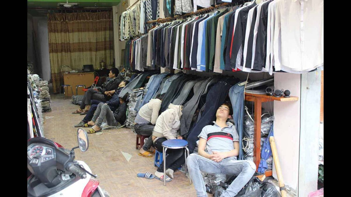 I took this photo in Hanoi in mid March. It seems everyone works to exhaustion there.