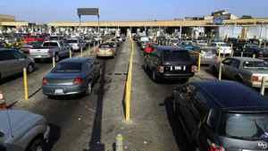 Motorists wait in lanes of traffic at the U.S. border crossing in San Ysidro, California September 27, 2011.