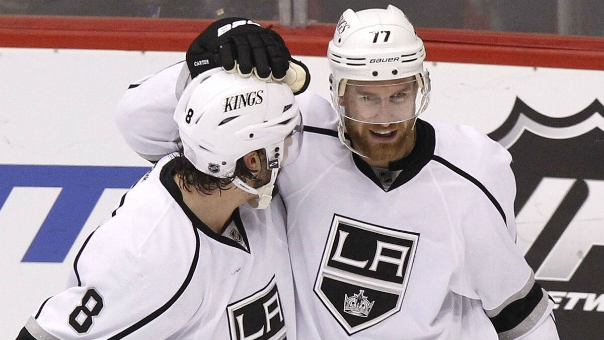 Los Angeles Kings' Jeff Carter (77) celebrates his third goal of the game with Drew Doughty