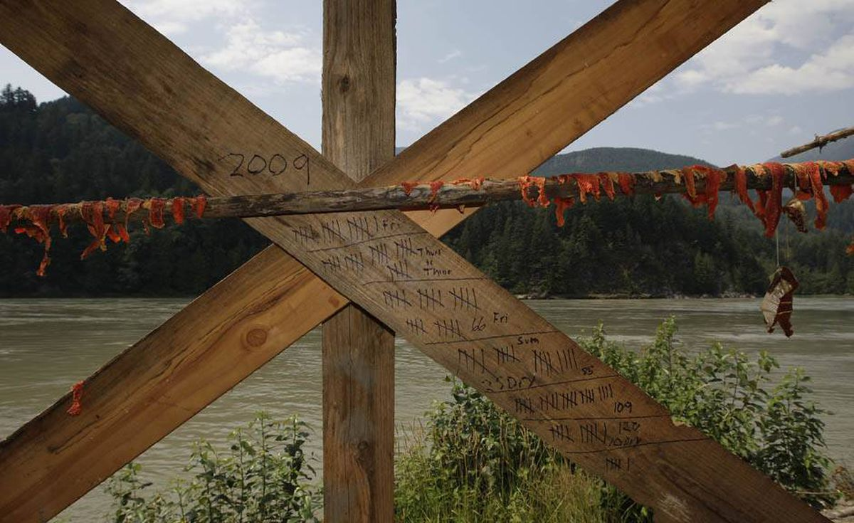 A ledger kept by Tyrone McNeil of the Sto;lo Tribal Council keeps track of sockeye salmon caught that will later be cut into strips to be hung on a dry rack to cure for up to ten days on the banks of the Fraser river near Hope, BC.