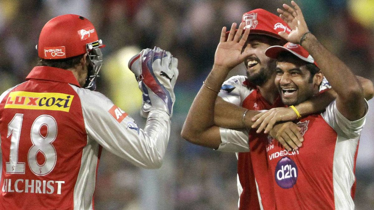 Paras Dogra, front right, Harmeet Singh, back right, of Kings XI Punjab celebrate with teammate Adam Gilchrist the dismissal of Jacques Kallis of Kolkata Knight Riders during their Indian Premier League (IPL) cricket match in Kolkata, India, Sunday, April 15, 2012. (AP Photo/Bikas Das)