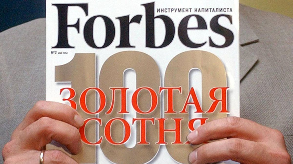 A copy of the real Russian Forbes magazine is seen in Moscow in this file photo. Forbes is suing the Russian publisher of a phony version.