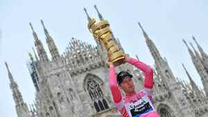 Canada's Ryder Hesjedal holds the trophy after winning the 95th Giro d'Italia, Tour of Italy cycling race, in Milan, Italy, Sunday, May 27, 2012.