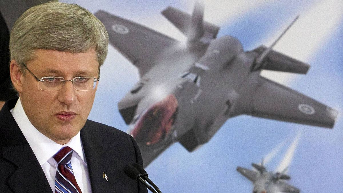 Prime Minister Stephen Harper speaks to employees, at Virtek Vision International Inc. in Waterloo Ontario March 11, 2011. Prime Minister Harper toured the high tech facility, which deals with lasers and manufacturing the materials used in the new F35 fighter jet, Canada's military is awaiting.
