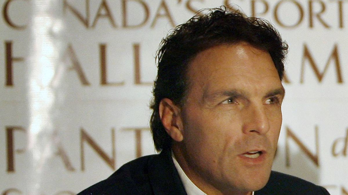 Former NFL and CFL football quarterback Doug Flutie speaks during a news conference for Canada's Sports Hall of Fame inductees in Toronto October 25, 2007. Flutie is the first non-Canadian to be inducted to the Hall of Fame. REUTERS/Mike Cassese