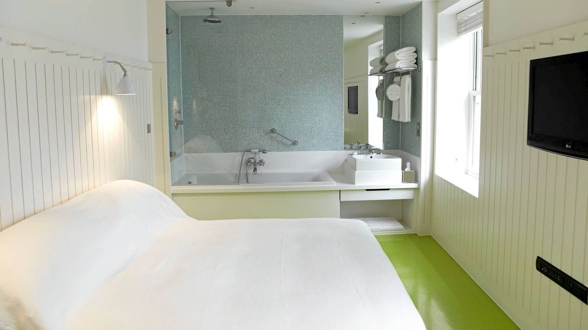 The design at London's St. John Hotel is a no-frills combination of whitewashed wooden walls, lime-green rubber floors and a sleek bathtub/shower outfitted with Penhaligon's toiletries.